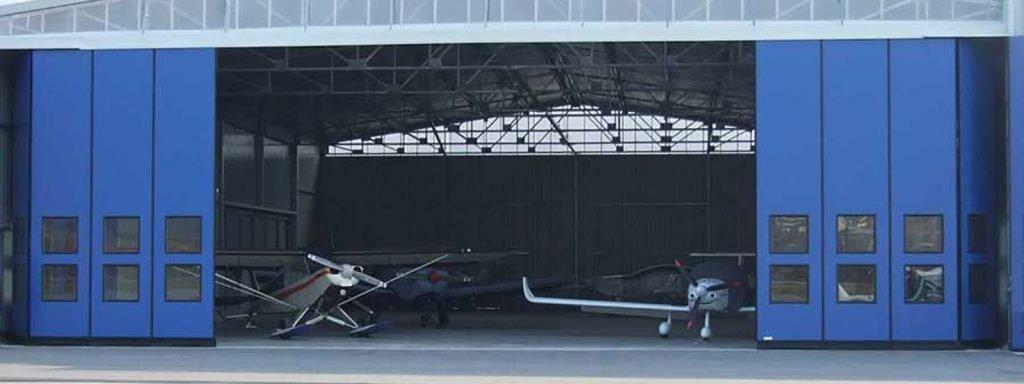 portone a libro hangar - Ferrari Porte